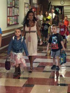 students walking through a hallway