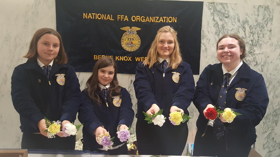 BKW FFA students hold boutineers they made for the Ag Day Celebration at the NYS Capitol