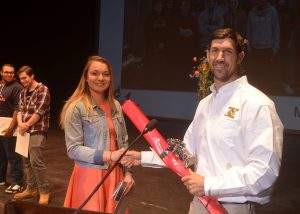 Taylor Vincent accepts the Golden Hammer Award at a CTE ceremony