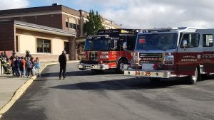 Fire trucks from Westerlo and Knox fire departments are parked in front of the school for Fire Prevention Week activities