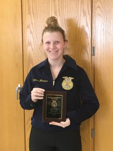 Kayleigh Reynolds-Flynn poses with her plaque from her sub-state FFA win