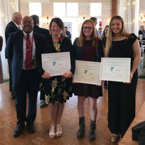Teacher Katyanna Keyser and students Courtney Sherwin and Morgan Thomas pose with Secondary School principal Dr. Mark Pitterson during the Capital District YMCA Outstanding Student and Educator Awards