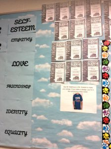 Individual pledges on a wall committing to stopping bullying