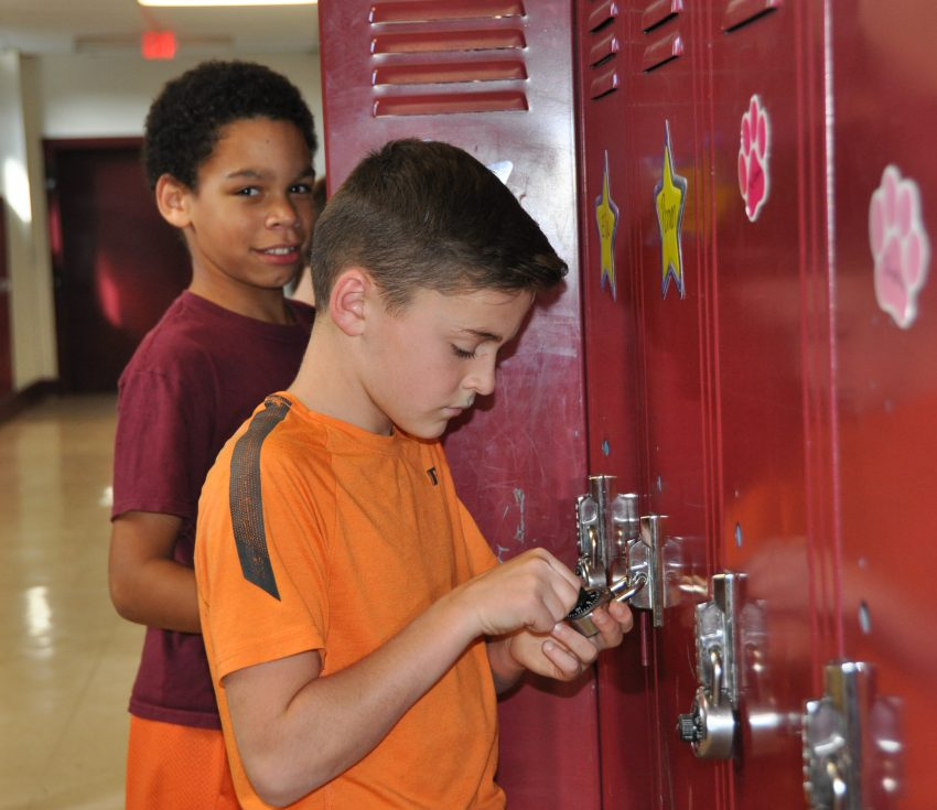 boy opening locker