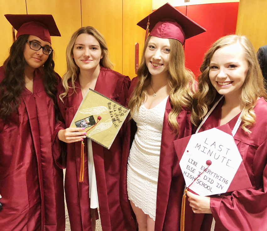 4 girls in their caps and gowns