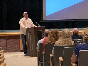 Nathan Elble speaks in auditorium