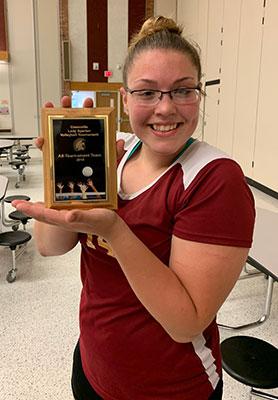 Reagan Smith holding award plaque