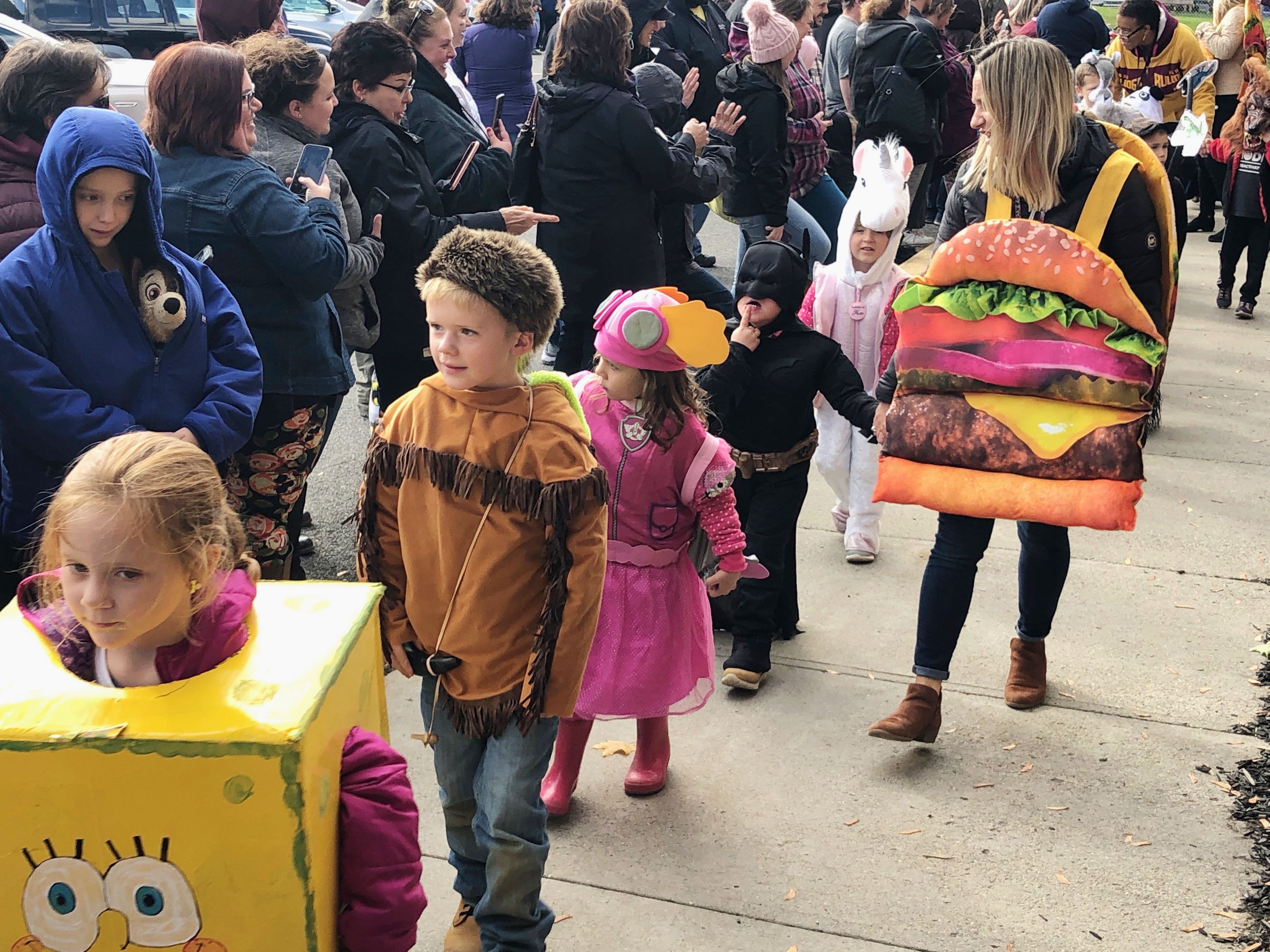 children march in halloween costumes