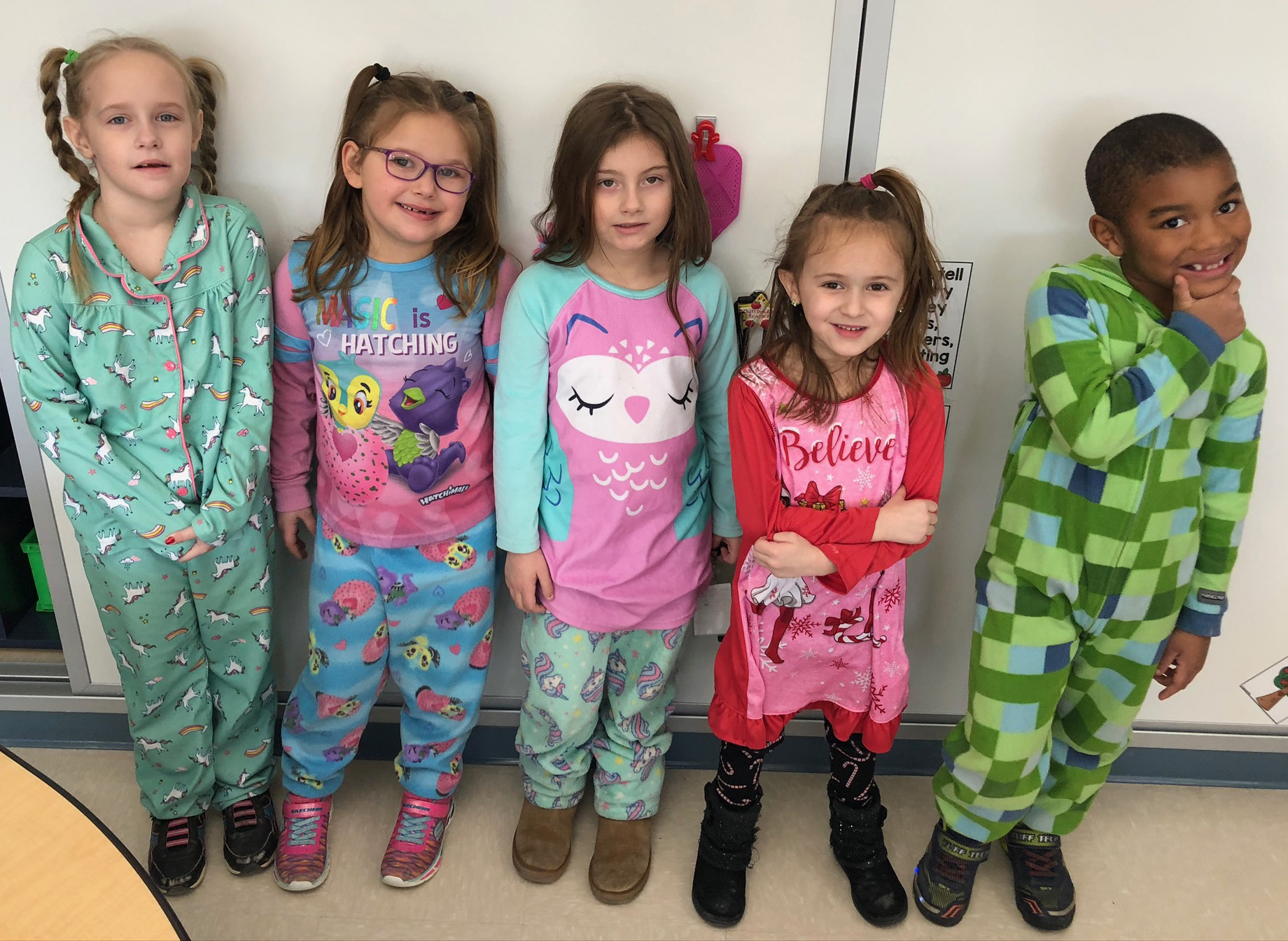 group of students wearing pajamas at school