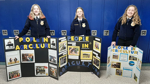 FFA students standing behind their displays