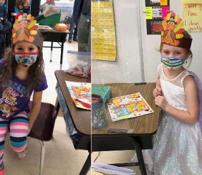 2 students wearing paper Thanksgiving headbands