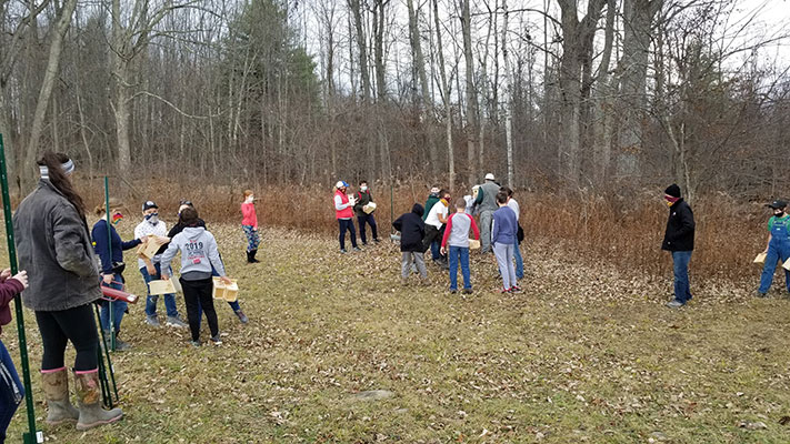 Kiwanis and students working on trail