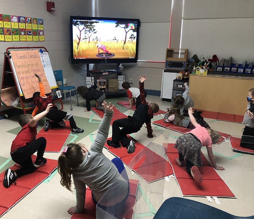 elementary students learning yoga