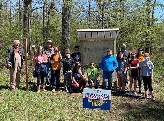 students standing by U'hai Trailhead sign
