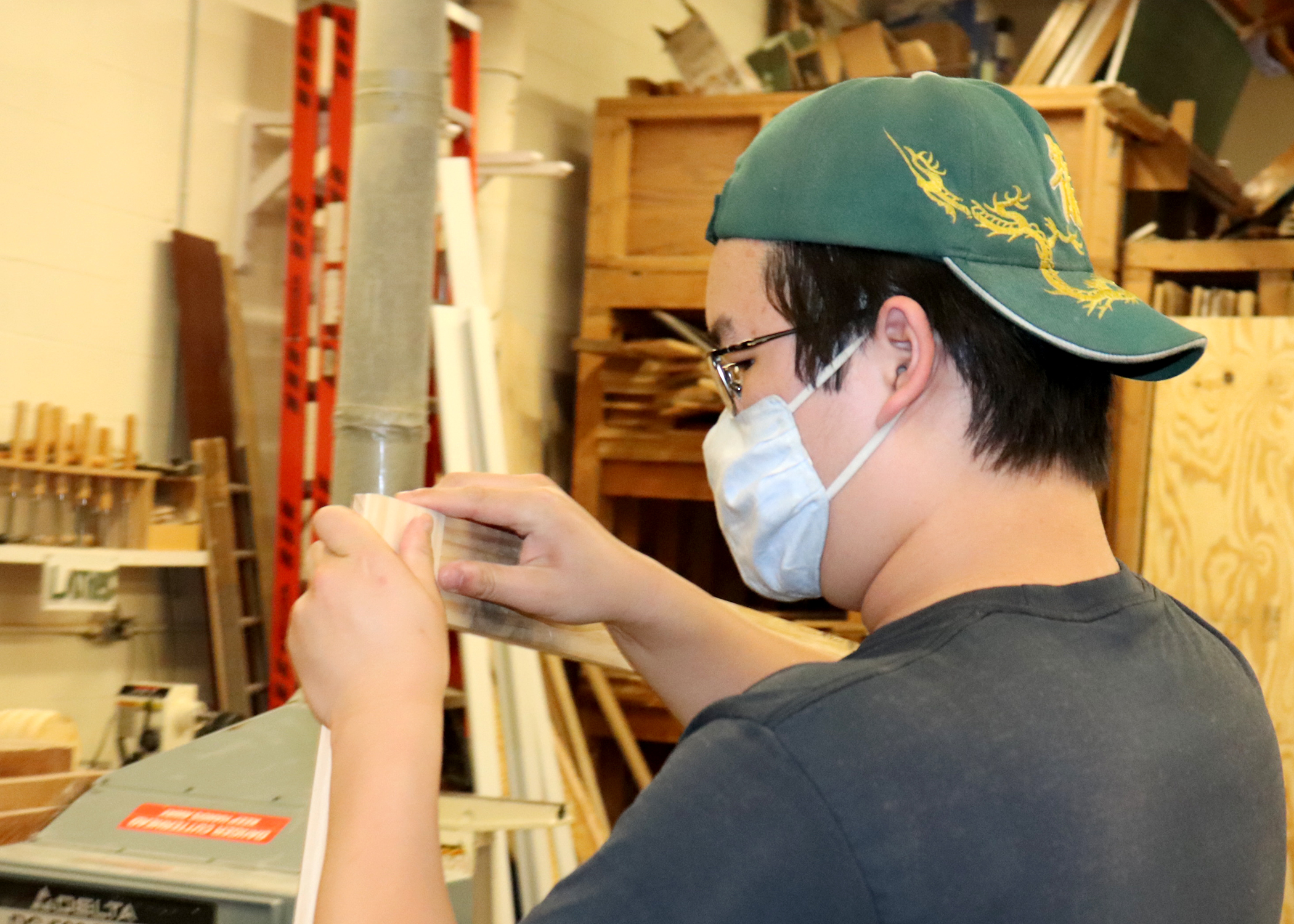 students works on a carpentry project