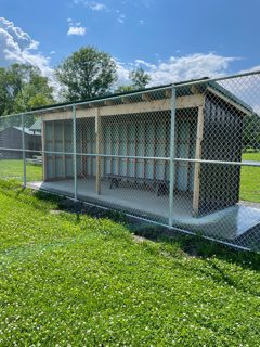 dugout with fence surrounding it