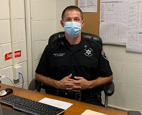 Deputy Hughes sitting at a desk