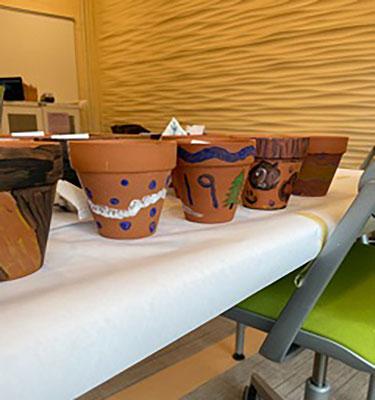 painted pots on a shelf